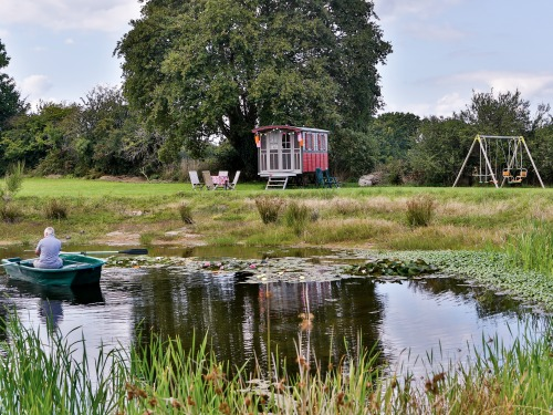 boat trip on the pond in front of the gipsy caravan